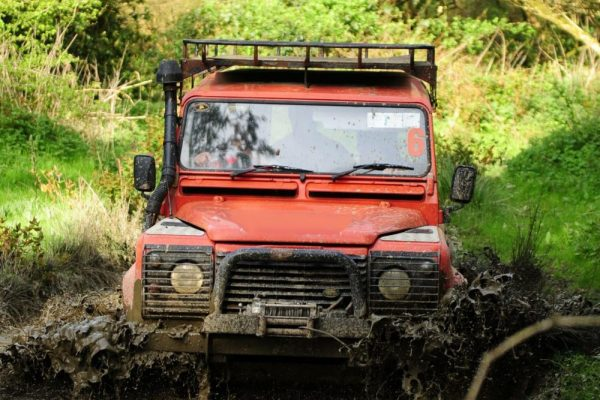 Orangeworks Land Rover driving through dirt tracks during off road driving at Carton House