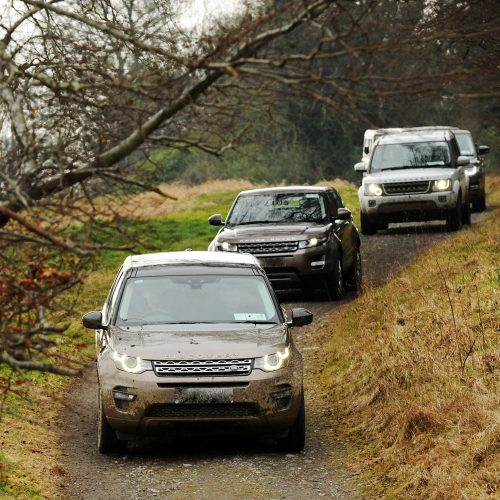 Land rover vehicles driving through a 4 x 4 track for a professional driver training course with Orangeworks.